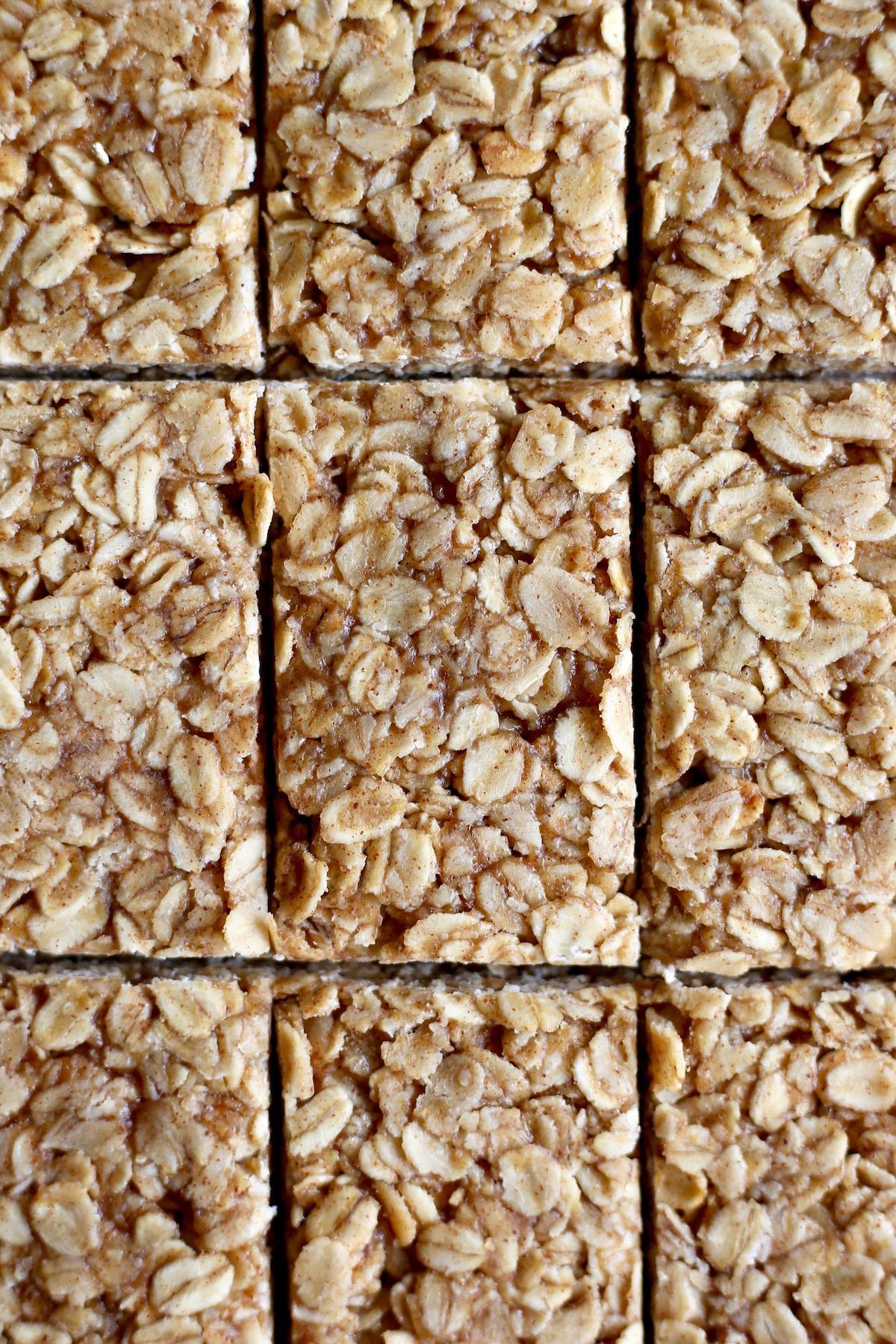 A sheet of homemade no-bake granola bars cut into rectangles