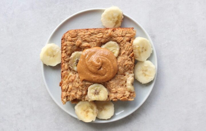 peanut butter banana baked oatmeal topped with more peanut butter and banana