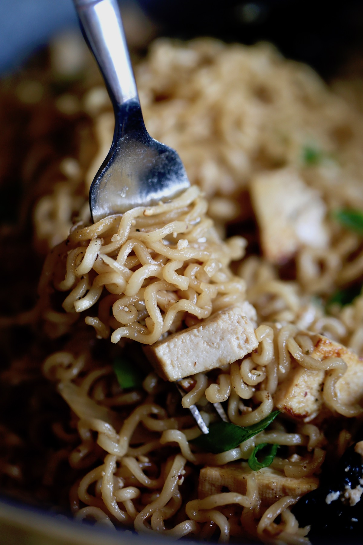 easy asian ramen noodles being scooped up with a fork