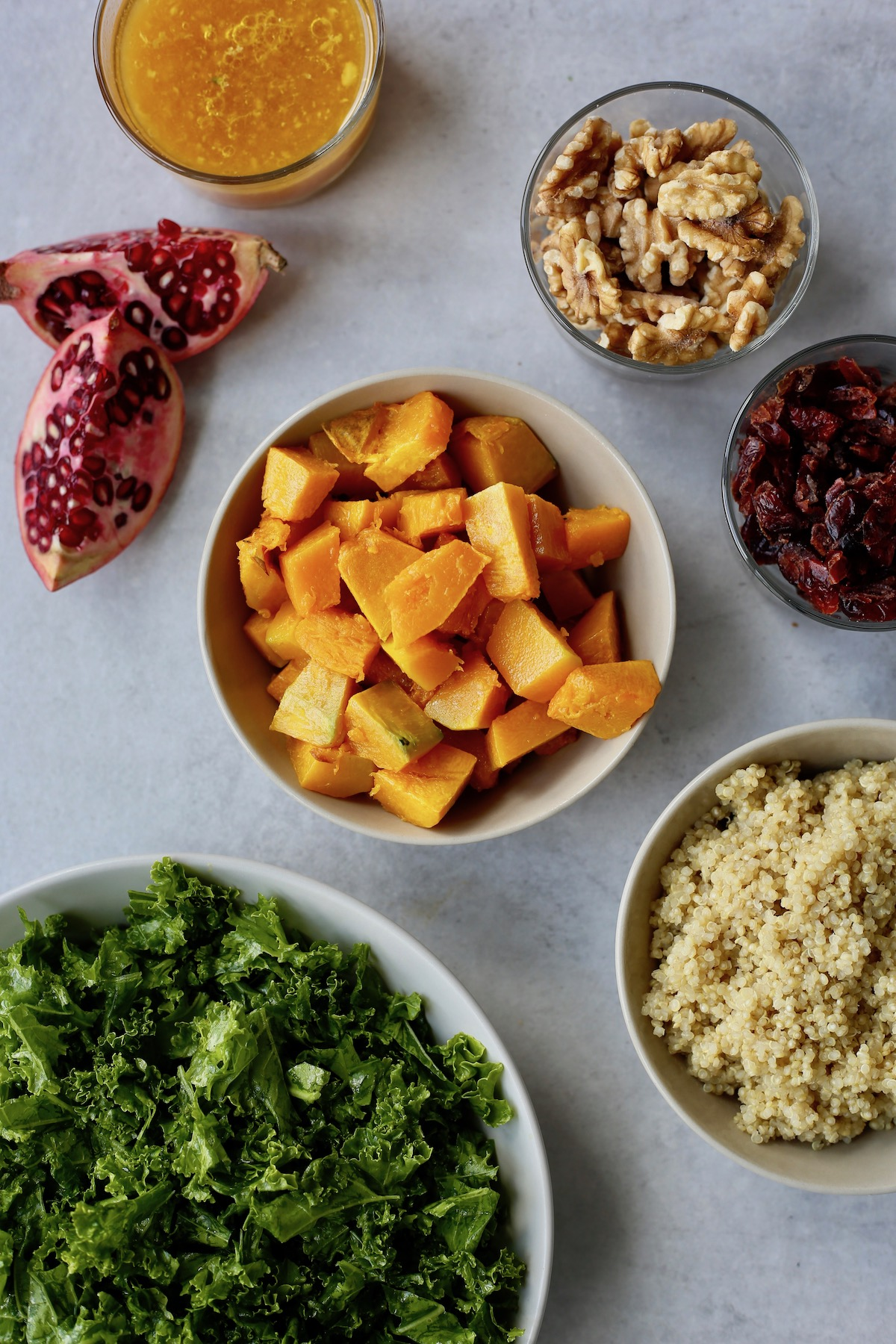The ingredients you'll need for quinoa, kale and squash salad laid out on a table