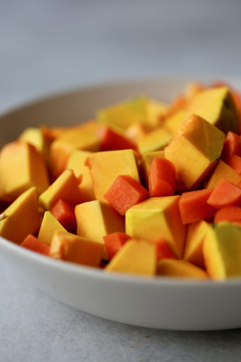 Chopped up pumpkin and carrot in a bowl