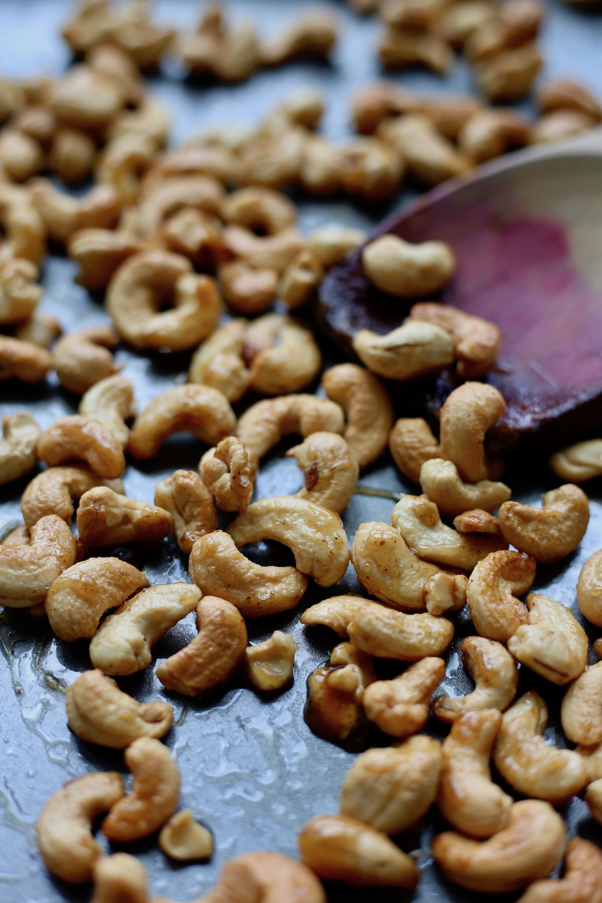 perfectly roasted candied spicy cashews on a baking sheet