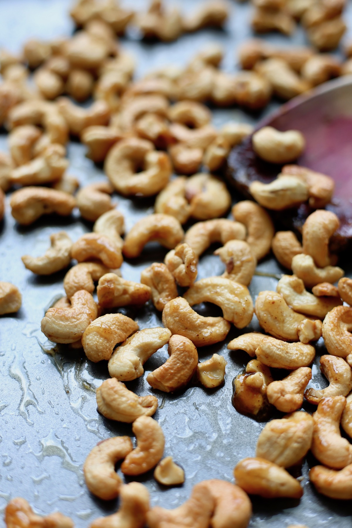 sweet and spicy roasted cashews on a baking sheet