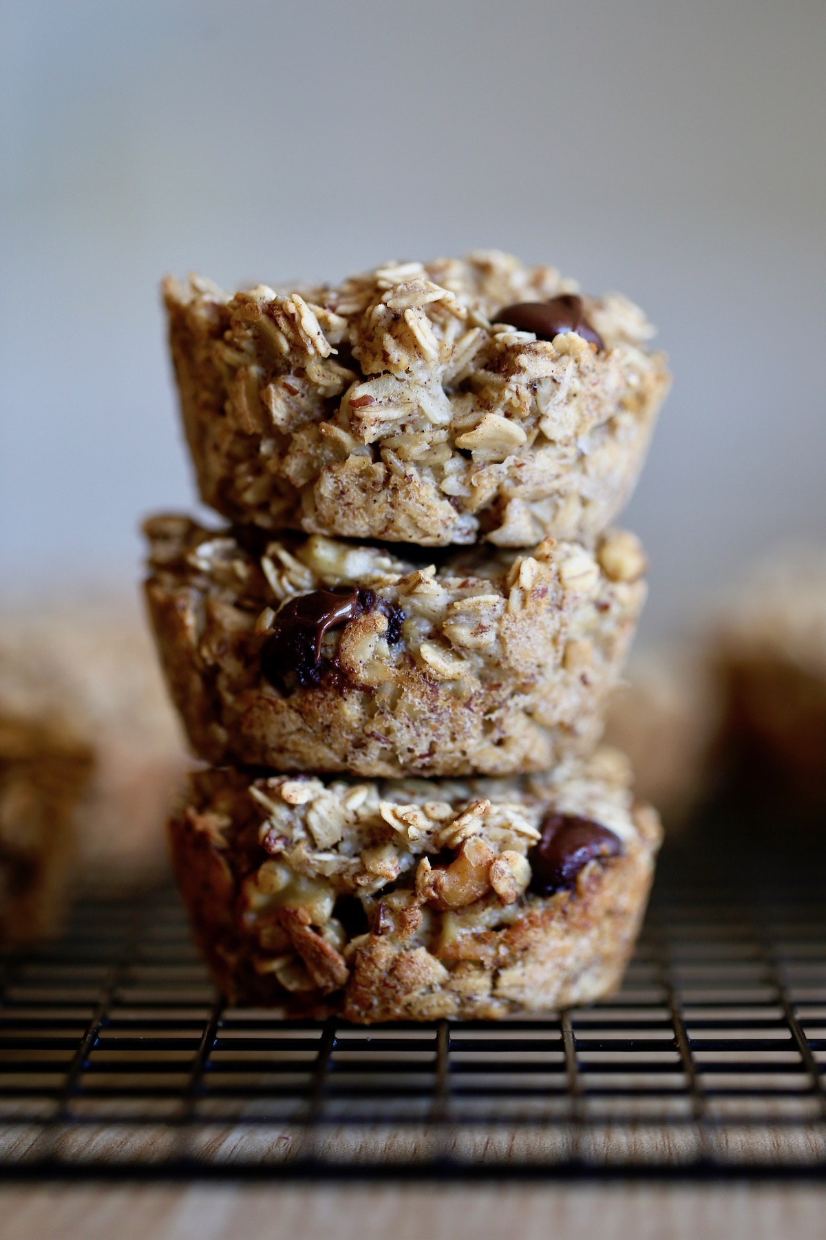 chunky monkey baked oatmeal muffin cups stacked on each other