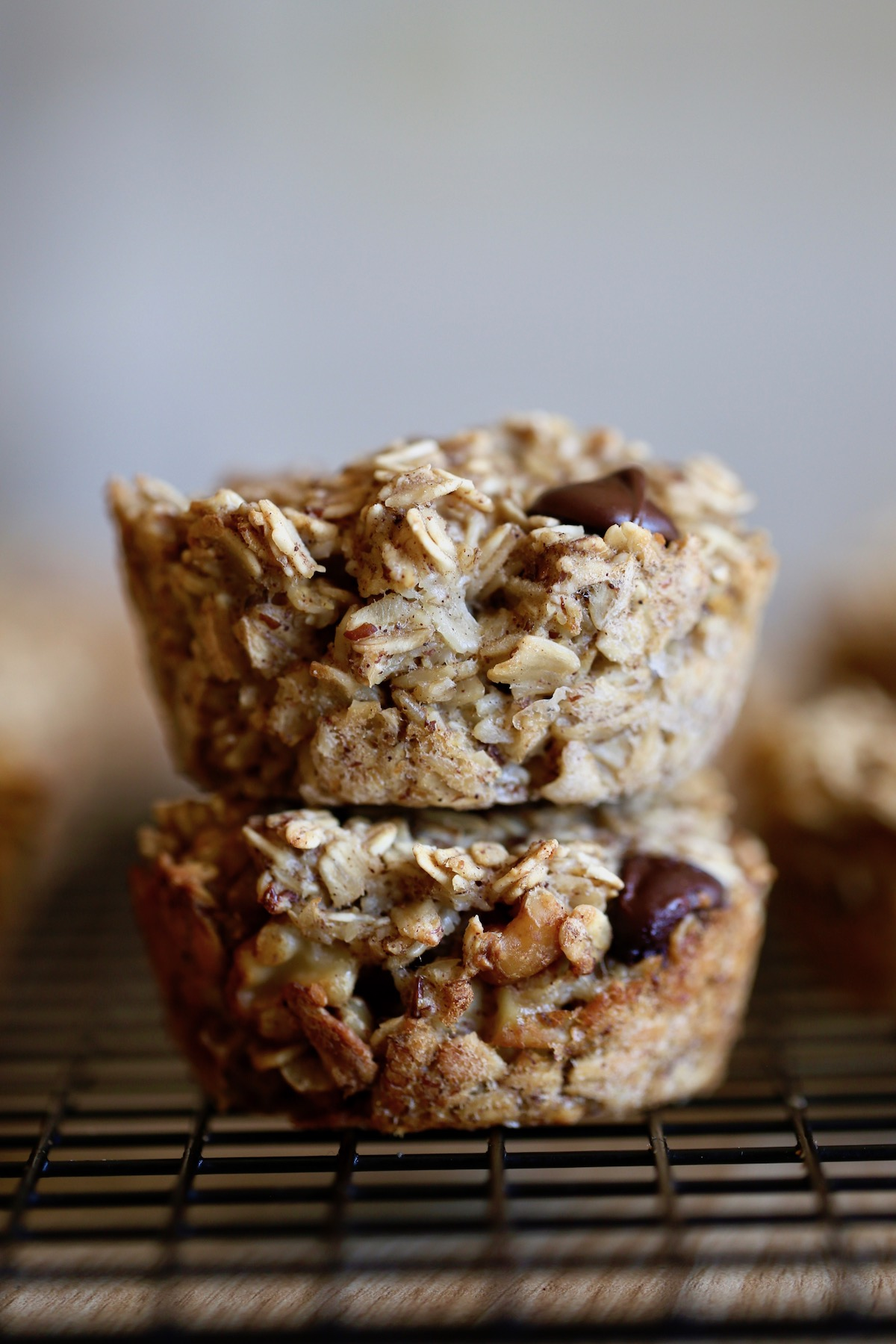 two banana, walnut, chocolate chip vegan baked oatmeal muffin cups stacked on each other