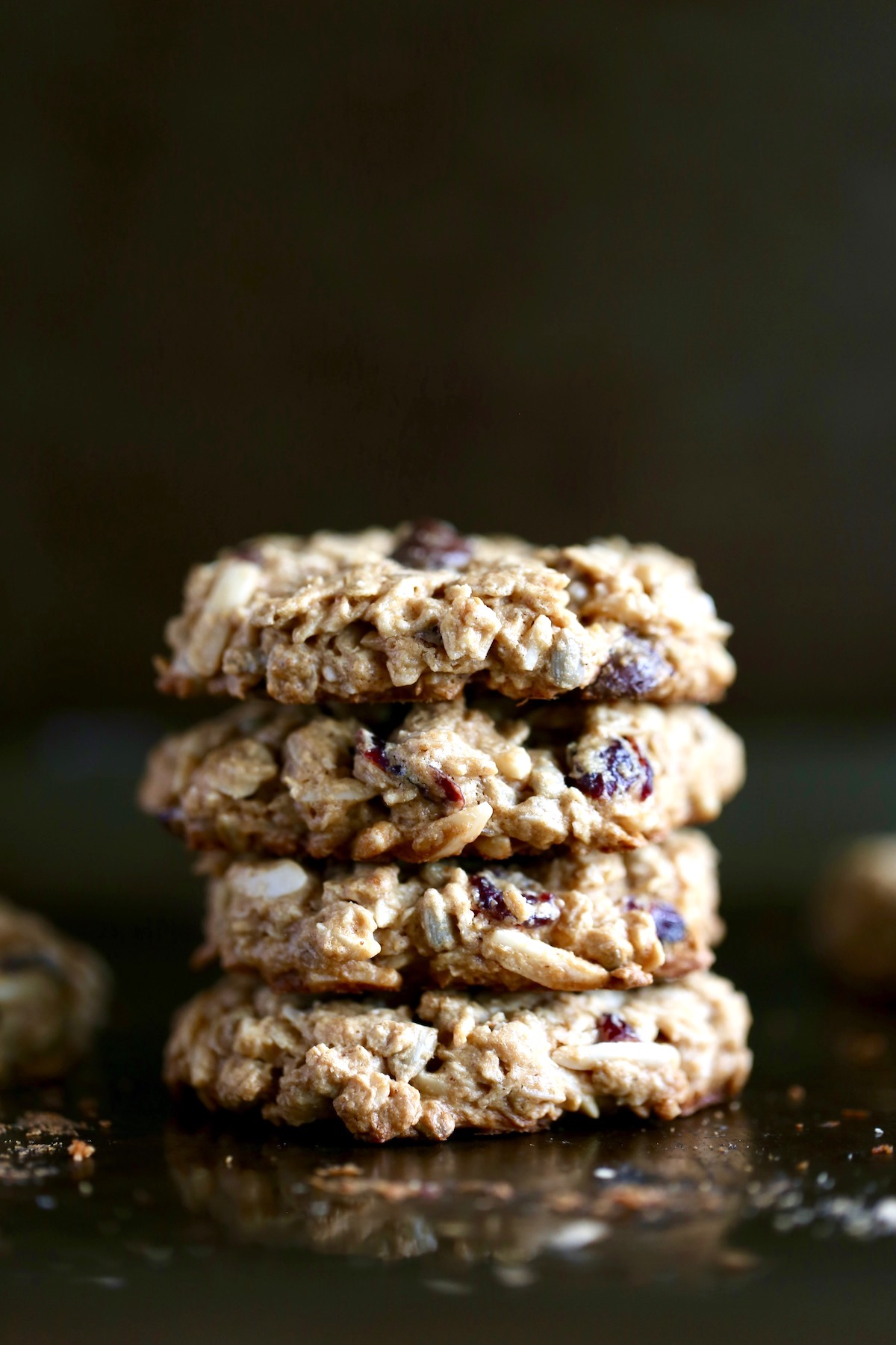 4 vegan breakfast cookies stacked on top of each other on a baking sheet