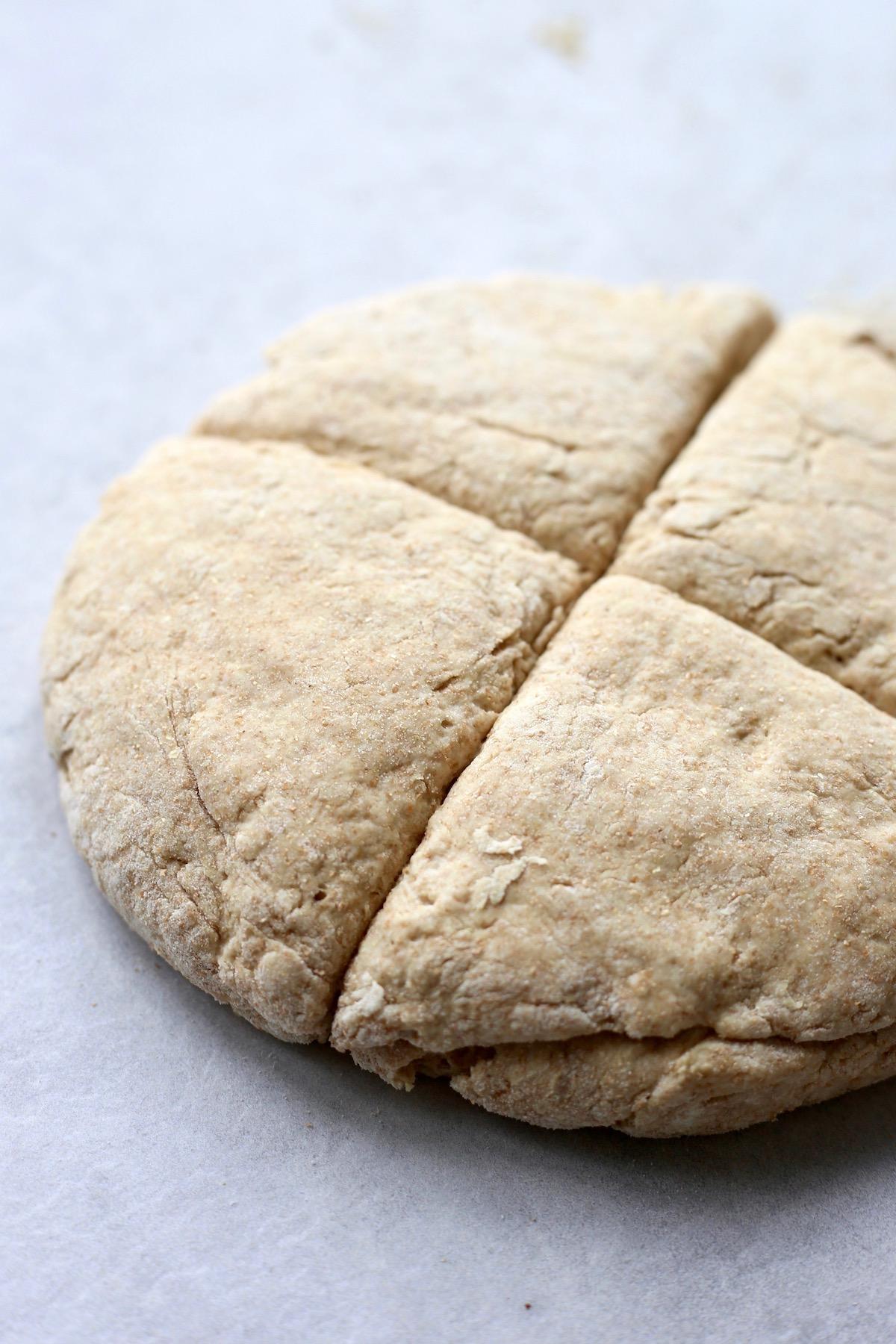 Soda bread dough cut into fourths to make soda farls