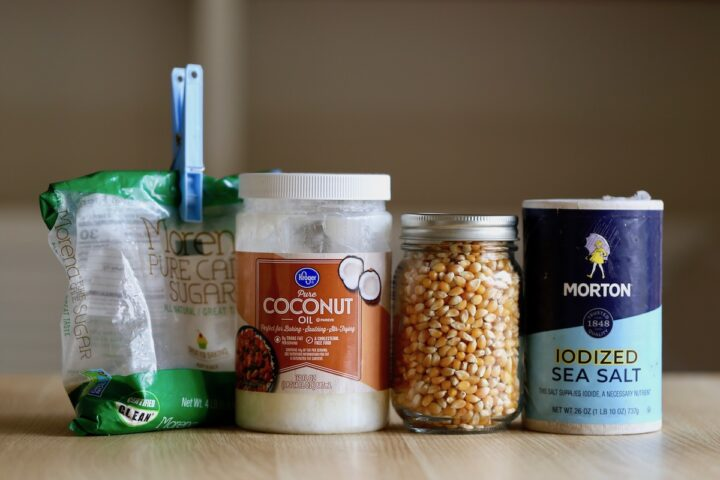 the ingredients you need to make vegan kettle corn laid out on a table