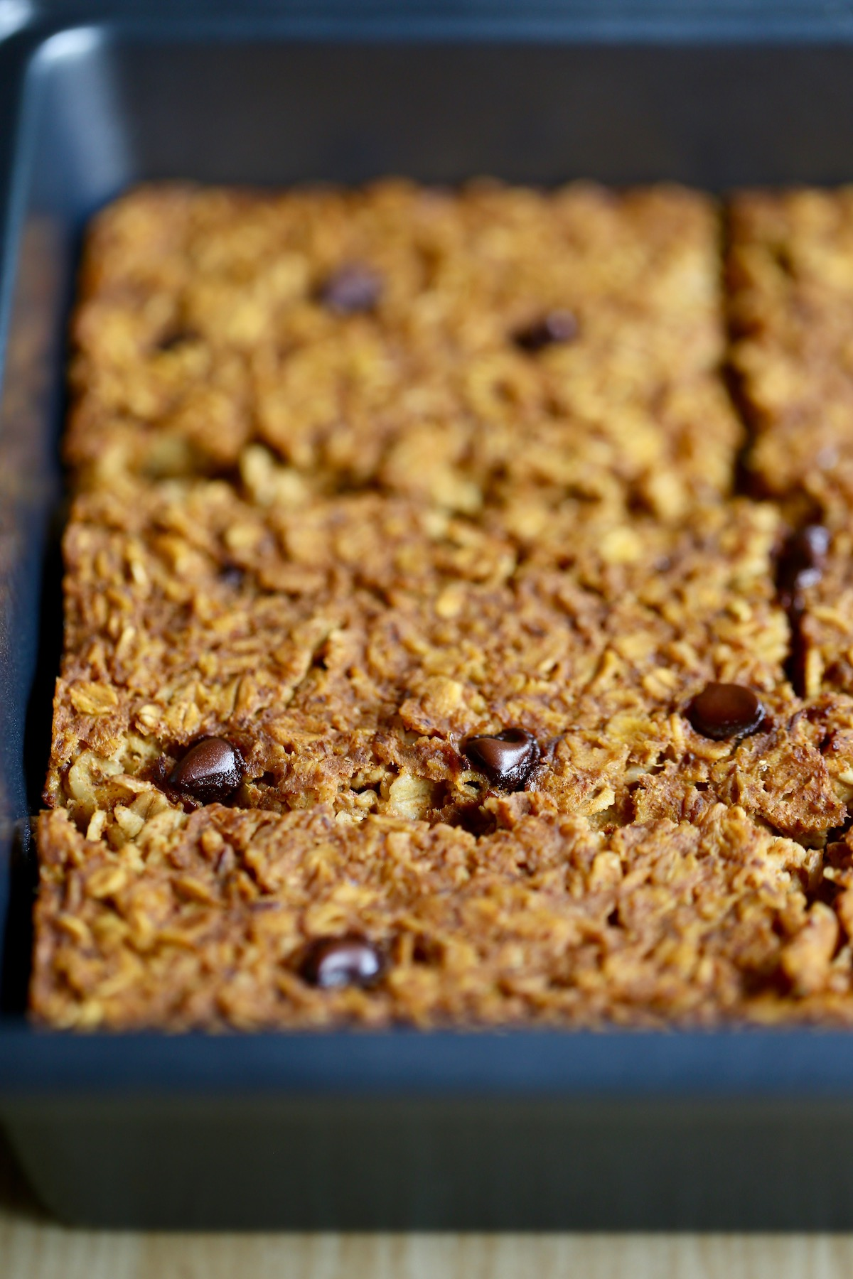vegan pumpkin baked oatmeal studded with non-dairy chocolate chips