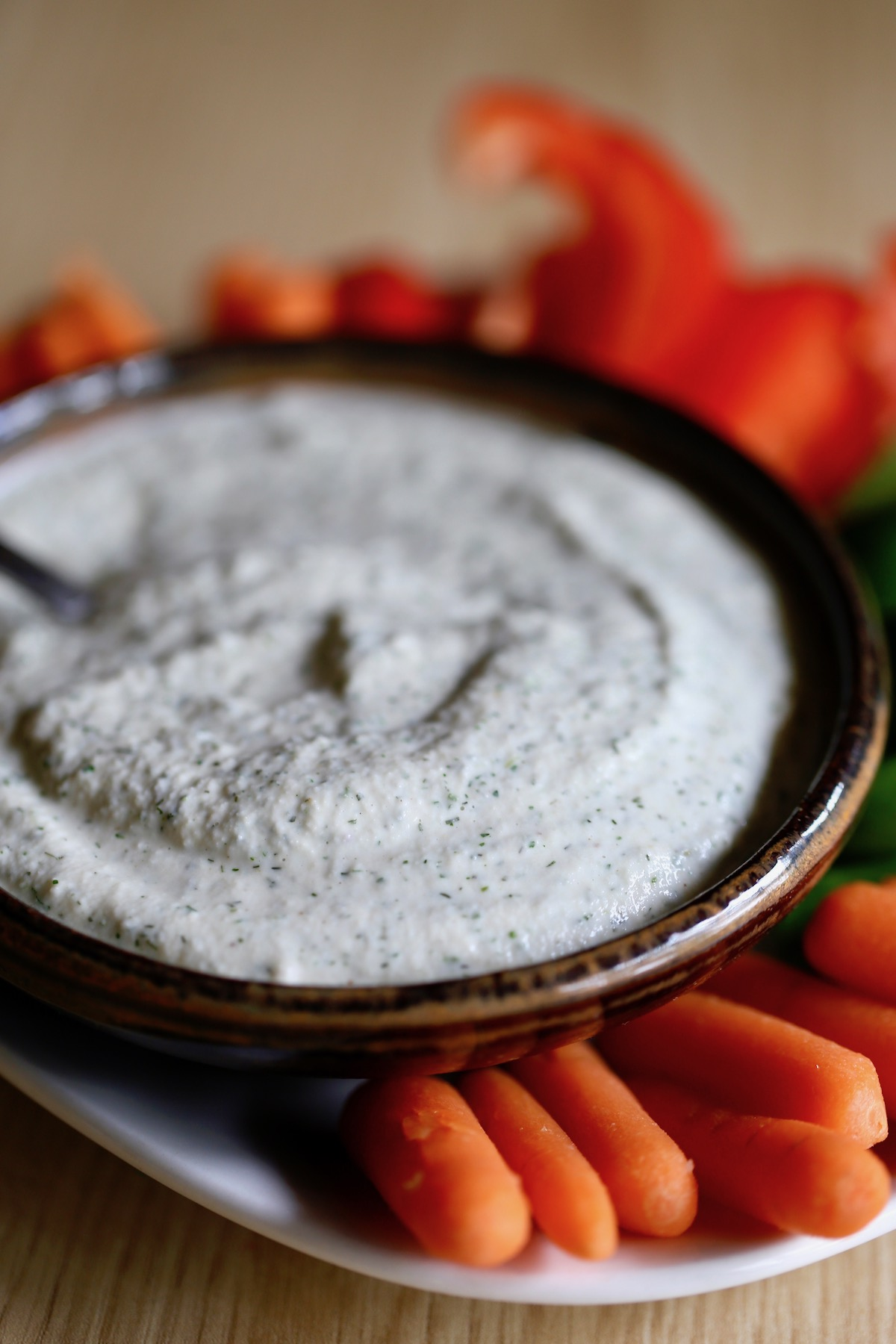 creamy homemade vegan ranch dressing in a bowl with veggies