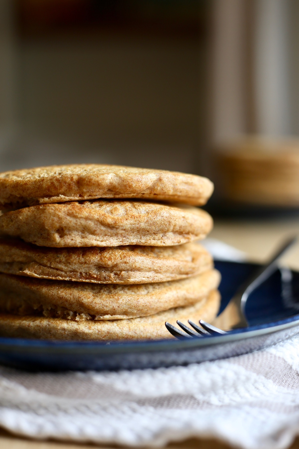 a stack of whole wheat vegan pancakes on a plate