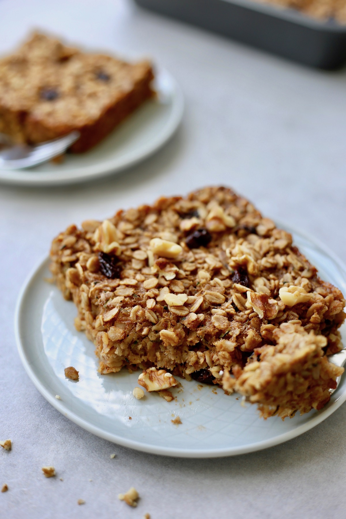 zucchini bread baked oatmeal being eaten off a plate